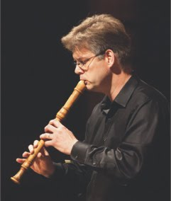 Rainer Beckmann, playing an alto recorder. Photo by Alexander Iziliaev